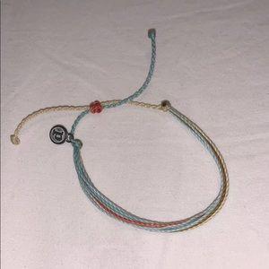 Teal, white, orange, green bracelet